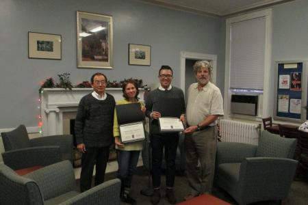 Dr. Mori and Dr. Black present teaching awards to Irina Kruchinina and Chuan-Haur Liu.